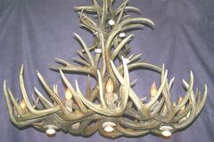 White tail deer pool-table chandelier by CDN Antler Designs.