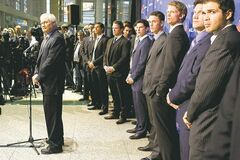 NHLPA Executive Director Donald Fehr, left, stands in front of players at a news conference following collective bargaining talks in Toronto on Thursday October 18, 2012. Negotiations continue between the NHL and the NHLPA to end the current lockout .THE CANADIAN PRESS/Chris Young