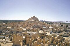 The labyrinthine Egyptian oasis of Siwa, with the famous Roman-era necropolis known as the Mountain of the Dead in the background.