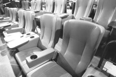 Cupholders and wide arm rests grace seats in Cineplex�s new VIP facility.