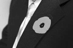Ret. Sergeant Tom Hoppe wears a poppy on his suit jacket at his house in Kingston, Ont., on Thursday, Nov. 8, 2012. Hoppe earned the Medal of Bravery and the affectionate nickname