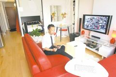 Khoa Dang, who lives in a 515-square-foot condo, feels his suburban friends have too many possessions.