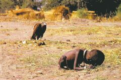 Kevin Carter's 1993 photo of a starving Sudanese girl being followed by a vulture won a Pulitzer prize. He came under criticism for snapping the photo rather than helping the girl. He committed suicide the following year.