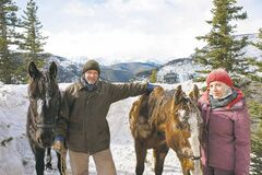 Aidan Quinn and Mackenzie Porter pose on location at the filming  of 'Horses of McBride' on Alberta's Moose Mountain. THE CANADIAN PRESS/HO, Bell/CTV