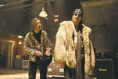 This film image released by Warner Bros. Pictures shows Alec Baldwin as Dennis Dupree, left, and Tom Cruise as Stacee Jaxx in New Line Cinema's rock musical Rock of Ages.