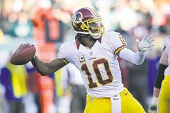 QB Robert Griffin III is playoff-bound if the Redskins beat Dallas Sunday.