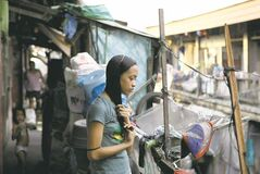 In this photo taken Dec. 4, 2012, Filipino slum dweller Jessa Balote holds her hair outside her cramped home at a place called Aroma in Tondo, Manila, Philippines. Balote, who used to tag along with her family as they collect garbage at a nearby dumpsite, is a scholar at Ballet Manila�s dance program. As an apprentice, she makes around 7,000 pesos ($170) a month, sometimes double that, from stipend and performance fees. (AP Photo/Aaron Favila)