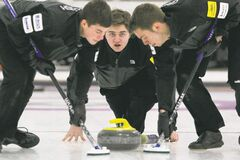 Matt Dunstone (middle) defeated Colin Kurz of Wildewood 8-3 to win the Tim Hortons Christmas Youth Bonspiel A Event Saturday.
