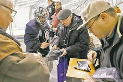 Jets goalie Al Montoya stops to sign autographs for fans after practice Wednesday.