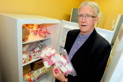 Researcher James Friel with frozen breast milk.