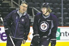 Winnipeg Jets head coach Claude Noel and Bryan Little share a laugh during Monday's practice before flying to Montreal to face the Habs tonight.