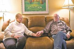 Elizabeth Allen, who has been diagnosed with early stage Alzheimer's, sits in her Toronto home with her husband of 20 years, Bob.