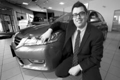 Phil Hossack / Winnipeg Free Press Birchwood Honda West's Dom Trotta with the popular new 2013 Honda Accord, which is moving off the lot at a brisk pace.