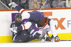 Jets' Dustin Byfuglien and Washington Capitals' Jason Chimera collide during the second period on Saturday.