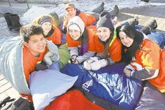 U of M students (from left) Justin Monton, Janelle Remillard, Colin McDougall, Morgan Fisher, Emily Ashley and Khrystyna Prokopovych set up their sleeping bags Sunday at the start of their 5 Days for the Homeless sleep-out.