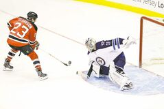 Ondrej Pavelec was huge Sunday, stopping 25 of 27 shots in regulation and this shootout try by David Clarkson.