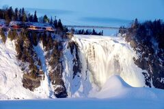 Montmorency Falls, east of Quebec City, is one of the region's top tourist attractions. The falls are also unique in that every winter they give birth to an offspring attraction -- the mountain of ice and snow at the base of the falls that forms as a result of mist from the cascading water crashing, rising up, freezing and falling back down again as a sort of icy snow. Over the winter months, the ice cone grows. It is called the Pain du sucre, or Sugarloaf, because of its shape.