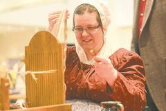 Debbie Young demonstrates  traditional weaving at the Manitoba Museum�s party Saturday.