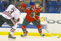 Mooseheads left-winger Jonathan Drouin relays the puck as Winterhawks defenceman Seth Jones applies pressure.