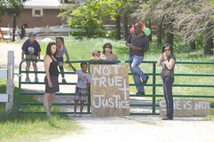 Friends and supporters of Aesgard Ranch  owner Arrayl Mason (left and fifth from left above) face off with protestors at her horse-boarding ranch Saturday. Mason says she has done nothing wrong and that the horses are like her �children.�