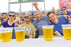 Winnipeg Blue Bombers fans enjoy a few cold ones at their first game at Investors Group Field. Overall, the crowd seemed to enjoy the new digs. Even the Blue cheerleaders were flipping out over the place.