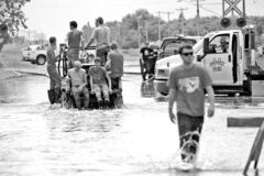 Reston residents make their way through some deep water  Saturday afternoon.