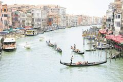 The busy Grand Canal in the Rialto neighbourhood of Venice.