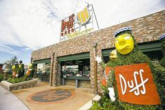 This Sept. 5, 2013 photo shows the entrance to Duff Gardens, serving Duff beer, at The Simpsons-themed Springfield U.S.A. at Universal Orlando in Orlando, Fla. The new zone is heavy on the tasty-yet-unhealthy food featured on the show. (AP Photo/John Raoux)