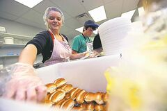 Kayla Proteau does her part in the kitchen.