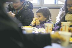 Four-year-old Julissa Pierre enjoys a pancake breakfast at the Salvation Army Christmas breakfast Saturday morning.
