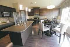 Kitchen finishes include cappuccino and thunder maple cabinets, maple hardwoods and laminate countertops.