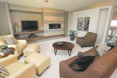 The family room is defined by beige berber carpet and an optional fireplace/entertainment unit combo.