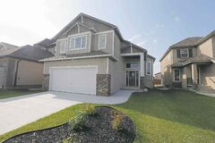 14 Tychnonick Bay in Kildonan Green ,  Hilton Homes� Spencer Curtis,   Plessis Road north well past Kildare, then turn left on Devonshire Drive, left on Tommy Douglas Drive and then left on to Tychonick Bay. Story by Todd Lewys . July 21 2014 / KEN GIGLIOTTI / WINNIPEG FREE PRESS