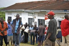 People watch the site where gunmen attacked outside the Gamba police station in Gamba, Kenya, Sunday, July 6, 2014. Eighteen people were killed in overnight attacks by the gunmen in two counties on the Kenyan coast, where last month al-Qaida-linked militants claimed responsibility for killing 65 people, the Kenya Red Cross said Sunday. The Sunday attacks took place in the towns of Hindi in Lamu county and Gamba in Tana River, the Kenya Red Cross chief Abbas Gulet said. Al-Qaida-linked al-Shabab militants from Somalia claimed responsibility for the attacks. (AP Photo)