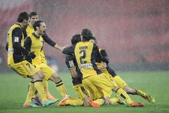 Atletico de Madrid's Raul Garcia, with shirt number eight, celebrates his goal after scoring against Athletic Bilbao, during their Spanish Copa del Rey round-8 second leg soccer match, at San Mames stadium, in Bilbao, northern Spain, Wednesday, Jan. 29, 2014. (AP Photo/Alvaro Barrientos)