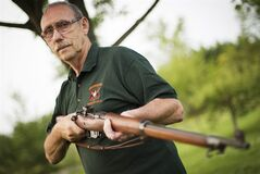 Bob McCormick holds one of his Canadian-made, WWI-era Ross rifles at his home in Haldimand, Ont., Thursday, August 7, 2014. When soldiers in the throes of battle discard their rifles and pluck a different weapon from the hands of dead allies, there's clearly a serious problem. So it was with the Ross rifle, the weapon that Canadian soldiers took with them to the start of the First World War a century ago. THE CANADIAN PRESS/Aaron Lynett