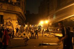 Protesters clash with police in front of the U.S. embassy in Cairo, Egypt, early Thursday, as part of widespread anger across the Muslim world about a film ridiculing Islam's Prophet Muhammad.