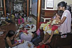 Residents take shelter at the lobby of the city hall in Tandag, Surigao Del Sur province in southern Philippines, Friday, following a 7.6 magnitude earthquake that struck eastern and southern Philippines. The quake set off car alarms, shook items off shelves and sent many coastal residents fleeing for high ground before the Pacific Tsunami Warning Center lifted all tsunami alerts it had issued for the Philippines and neighboring countries from Indonesia to Japan, and for Pacific islands as far away as the Northern Marianas.