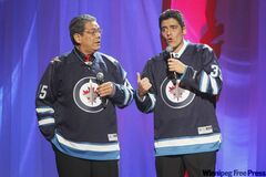 Hosts Lorne Cardinal (left) and Kyle Nobess donned Jets jerseys at the 2011 Aboriginal Peoples Choice Music Awards on Friday.