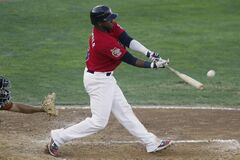 The Goldeyes' Yurendell de Caster hits a grand slam home run against the Sioux Falls Pheasants on Tuesday. He's batting .347 so far this year.