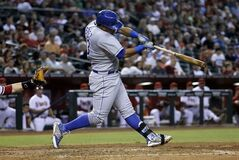 Kansas City Royals' Salvador Perez swings on a three-run home run against the Arizona Diamondbacks during the third inning of a baseball game, Tuesday, Aug. 5, 2014, in Phoenix. (AP Photo/Matt York)