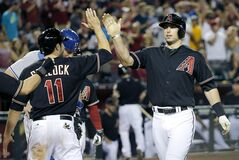 Arizona Diamondbacks' Paul Goldschmidt, right, high-fives A.J. Pollock after hitting a three-run home run against the Los Angeles Dodgers during the seventh inning of a baseball game Saturday, May 17, 2014, in Phoenix. (AP Photo/Matt York)