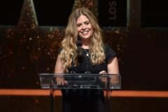 Jennifer Lee accepts the 2014 Dorothy Arzner directors award at the Women In Film 2014 Crystal And Lucy Awards at the Hyatt Regency Century Plaza on Wednesday, June 11, 2014, in Los Angeles. (Photo by John Shearer/Invision/AP)
