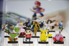 In this June 10, 2014 file photo, amiibo characters for Wii U are on display at the Nintendo booth during the Electronic Entertainment Expo, in Los Angeles. Pikachu and Link will be among the first characters coming to