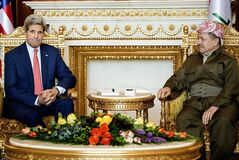 Kurdish regional President Massoud Barzani, right, listens to U.S. Secretary of State John Kerry during a meeting at the presidential palace in Irbil, Iraq, Tuesday, June 24, 2014. Kerry arrived in Iraq's Kurdish region in a US diplomatic drive aimed at preventing the country from splitting apart in the face of militants pushing towards Baghdad. (AP Photo/Brendan Smialowski, Pool)
