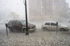 A hail storm hits downtown Colorado Springs, Colo., Wednesday, May 21, 2014. (AP Photo/The Gazette, Christian Murdock) MAGAZINES OUT.