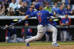 Chicago Cubs' Javier Baez flies out against the Colorado Rockies in the fifth inning of the Rockies' 13-4 victory in a baseball game in Denver on Wednesday, Aug. 6, 2014. (AP Photo/David Zalubowski)