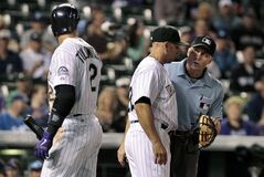 Colorado Rockies manager Walt Weiss, center, steps between home plate umpire Dan Iassogna, right, and Colorado Rockies shortstop Troy Tulowitzki (2) after Iassogna ejected Tulowitzki following an argument in the ninth inning of the Rockies 7-2 loss to the Los Angeles Dodgers in a baseball game in Denver on Friday, June 6, 2014. (AP Photo/Joe Mahoney)