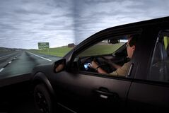 A test driver goes behind the wheel of Ford's VIRTTEX, a safety simulator that analyzes drivers' skills and reactions to dangerous situations on the road. THE CANADIAN PRESS/HO-FORD CANADA