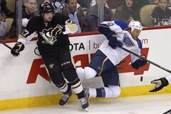 Pittsburgh Penguins' Simon Despres (47) collides with St. Louis Blues' Brenden Morrow (10) in the first period of an NHL hockey game in Pittsburgh, Sunday, March 23, 2014. THE CANADIAN PRESS/AP/Gene J. Puskar